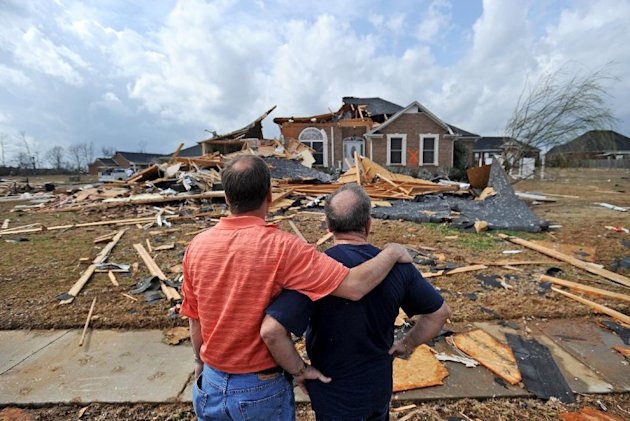 Jerry Vonderhaar, left, comforts Charles Kellogg after severe weather hit the Eagle Point subdivision in Limestone County, Ala. on Friday, March 2, 2012.  A reported tornado destroyed several houses i