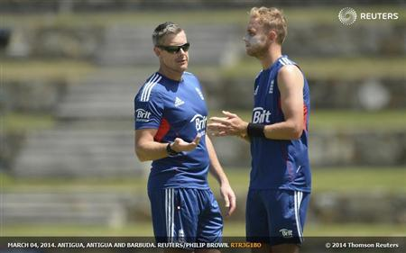 England's coach Giles talks to captain Broad during a training session before the third one-day international cricket match against the West Indies' at North Sound, Antigua