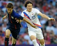 South Korea&#39;s Park Jong-Woo (R) and Japan&#39;s Takahiro Ohgihara during their bronze medal football match at the London Olympics on August 10. Park will be excused military service as a reward for his Olympic performance despite controversially displaying a sign on a territorial dispute, an official said