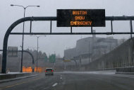 "A vehicle moves down a nearly empty highway as a sign warns of a snow emergency at the entrance to the Ted Williams Tunnel, Friday, Feb. 8, 2013 in Boston. Deval Patrick declared a state of emergency Friday and banned travel on roads as of 4 p.m. as a blizzard that could bring nearly 3 feet of snow to the region began to intensify. As the storm gains strength, it will bring ""extremely dangerous conditions"" with bands of snow dropping up to 2 to 3 inches per hour at the height of the blizzard, Patrick said. (AP Photo/Gene J. Puskar)"