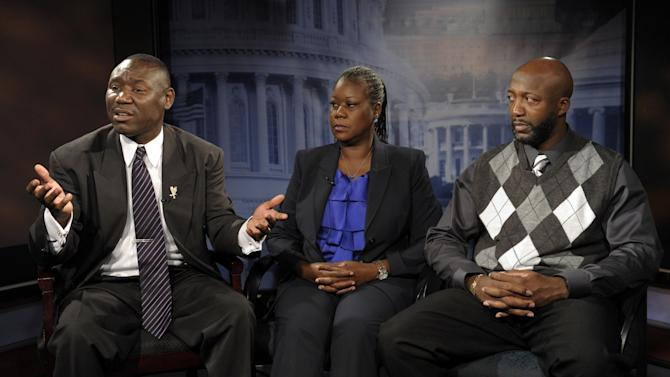 Ben Crump, left, attorney for Trayvon Martin's parents, left, and The Martin's parents, mother  Sybrina Fulton, center, and father Tracy Martin are interviewed by The Associated Press in Washington, Wednesday, April 11, 2012.  After weeks of mounting tension and protests across the U.S., a special prosecutor has decided to bring charges against neighborhood watch volunteer George Zimmerman in the killing of 17-year-old Trayvon Martin, a law enforcement official said Wednesday.  (AP Photo/Susan Walsh)