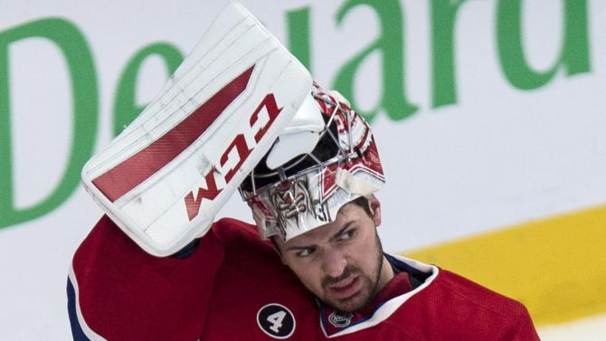Montreal Canadiens goalie Carey Price looks on following a goal by Tampa Bay Lightning's Vladislav Namestnikov during the second period of an NHL hockey game Monday, March 30, 2015, in Montreal. (AP Photo/The Canadian Press, Paul Chiasson)