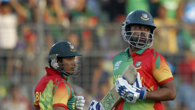 Bangladesh's Iqbal and Haque run between wickets against Afghanistan during ICC Twenty20 World Cup match in Dhaka