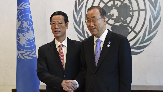 China's Vice Premier Zhang shakes hands with UN Secretary-General Ban at the U.N. headquarters in New York