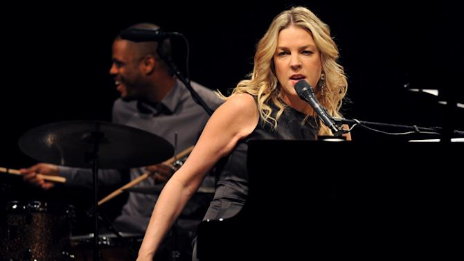 """FILE - In this Nov. 20, 2009 file photo, Canadian jazz pianist and singer Diana Krall performs in Universal Hall in Macedonia's capital Skopje. Krall played the standard """"Fly Me to the Moon"""" during a concert at the Hollywood Bowl in Los Angeles, Saturday, Aug. 25, 2012, in honor of astronaut Neil Armstrong, who died earlier in the day. (AP Photo/Boris Grdanoski, File)"""
