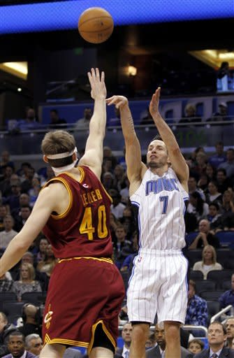 Nelson helps Magic outlast Cavs 108-104