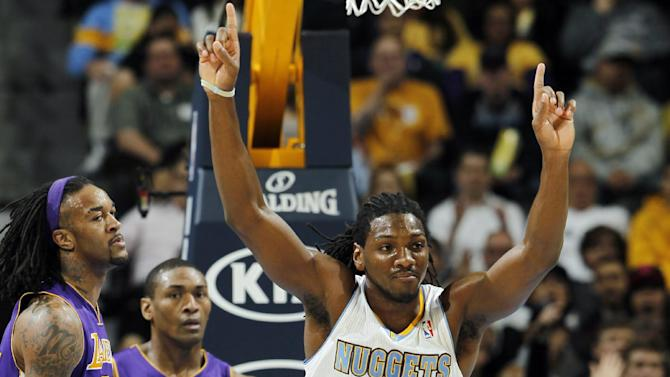 Denver Nuggets forward Kenneth Faried (35) celebrates after tipping the ball in to score as Los Angeles Lakers center Jordan Hill, left, and forward Metta World Peace (15) stand by in the first quarter of an NBA basketball game in Denver, Wednesday, Dec. 26, 2012. (AP Photo/David Zalubowski)