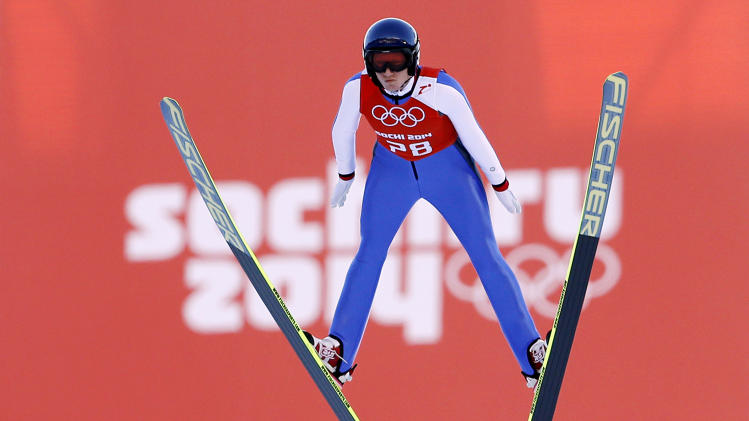 Austria's Daniela Iraschko-Stolz soars through the air during a women's ski jumping training session at the 2014 Winter Olympics, Saturday, Feb. 8, 2014, in Krasnaya Polyana, Russia. (AP Photo/Matthias Schrader)