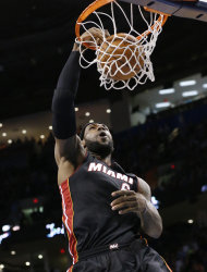 Miami Heat forward LeBron James (6) dunks during the first quarter of an NBA basketball game against the Oklahoma City Thunder in Oklahoma City, Thursday, Feb. 20, 2014. (AP Photo/Sue Ogrocki)