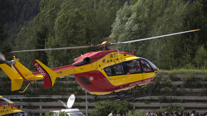 A French rescue helicopter arrives back from a search mission after an avalanche in the French Alps near Chamonix, France, swept at least nine climbers to their deaths, Thursday, July 12, 2012. About 28 climbers from Switzerland, Germany, Spain, France, Denmark and Serbia were believed to be involved in the expedition caught in the avalanche, according to the local gendarme service and Danish Foreign Ministry. (AP Photo/Anja Niedringhaus)