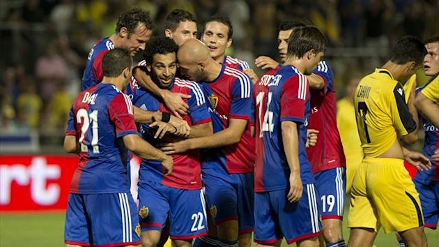 Switzerland's FC Basel midfielder Mohamed Sala (C) celebrates with teammates after scoring a goal against Maccabi Tel Aviv FC at the Bloomfield stadium in the coastal city of Tel Aviv (AFP)