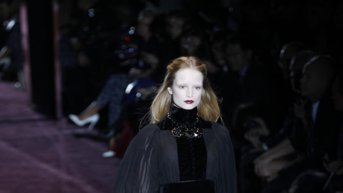FILE - This Feb. 22, 2012 file photo shows a model wears a creation of Gucci, part of the women's Fall-Winter 2012-2013 collection that was presented in Milan, Italy. Polished sophistication is the new trend after previous trends that have alternately favored bohemian, aggressive and blingy looks. (AP Photo/Luca Bruno, file)
