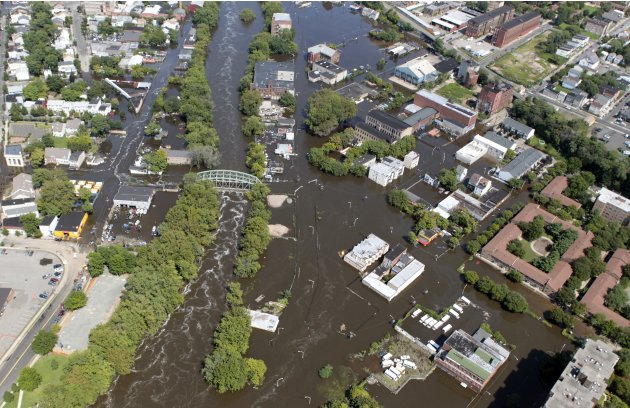 Flood waters from the Passaic River overrun the banks, filling the streets of Paterson