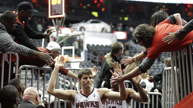 Atlanta Hawks  guard Kyle Korver greets fans as he leaves the court after an NBA basketball game against the Boston Celtics on Friday, Jan. 25, 2013, in Atlanta. Korver scored 27 points to help Atlanta win 123-111 in double-overtime. (AP Photo/John Bazemore)