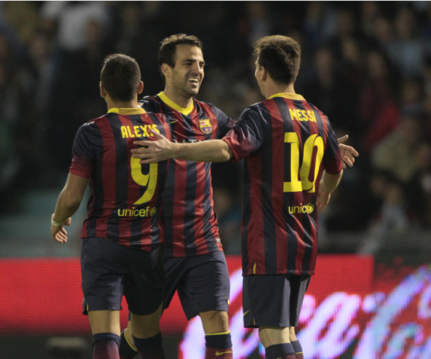FC Barcelona's Cesc Fbregas, center, celebrates with Alexis Sanchez from Chile, left, and Lionel Messi from Argentina, right, after scoring the third goal against RC Celta during a Spanish La Liga soc