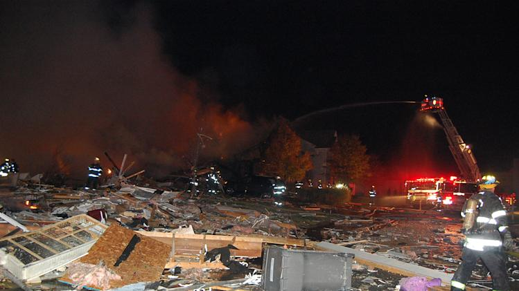 In this photo provided by the Indianapolis Fire Department, firefighters work the scene where an explosion and fire has killed two people and damaged more than a dozen homes late Saturday and early Sunday, Nov. 11, 2012, in the Richmond Hill subdivision in Indianapolis. (AP Photo/Indianapolis Fire Department)