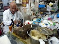 Salman al-Khafaji works at his clinic in central Baghdad. He says his patients also include foreigners living in Iraq -- people hailing from Bangladesh, India, and from other Arab countries