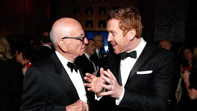 IMAGE DISTRIBUTED FOR FOX SEARCHLIGHT - Rupert Murdoch, left, and actor Damian Lewis attend the Fox Golden Globes Party on Sunday, January 13, 2013, in Beverly Hills, Calif. (Photo by Todd Williamson/Invision for Fox Searchlight/AP Images)