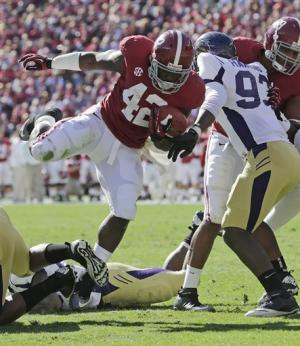 Lacy scores 3 TDs, No. 4 Bama rolls over WCU 49-0