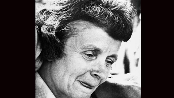 FILE - In this July 30, 1979 file photo, Louise Bundy, mother of convicted killer Ted Bundy, leaves court in Miami. Bundy, who was a staunch defender of her serial killer son before he made a series of death-row confessions, died in December 2012 after a long ilness. She was 88. (AP Photo, File)