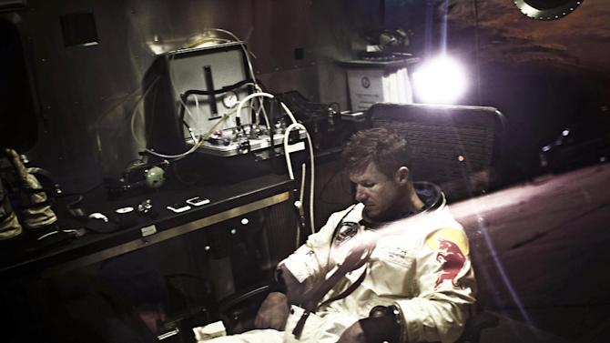 In a photo provided by Red Bull, pilot Felix Baumgartner of Austria, sits in his trailer during the preparations for the final manned flight of the Red Bull Stratos mission in Roswell, N.M. on Saturday, Oct. 6, 2012.  Red Bull Stratos announced Friday that the jump by extreme athlete Baumgartner have been moved from Monday to Tuesday, Oct. 9,  due to a cold front with gusty winds. The jump can only be made if winds on the ground are under 2 mph for the initial launch a balloon carrying Baumgartner. (AP Photo/Red Bull, Joerg Mitter)