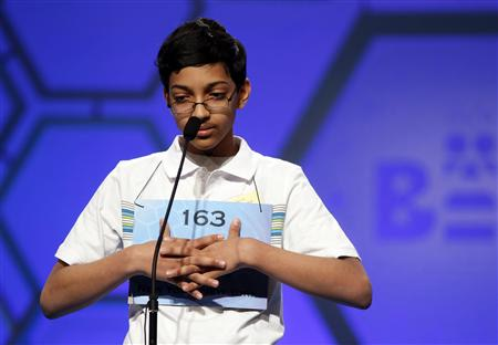 New York student Arvind Mahankali of Bayside Hills spells in the semi-final round of the 2013 Scripps National Spelling Bee at the Gaylord National Resort and Convention Center at National Harbor in Maryland, May 30, 2013. REUTERS/Larry Downing
