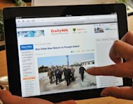 A man looks at the webpage of Daily NK on an iPad. Daily NK is one of about a dozen South Korean organisations collecting news about the North, through sources inside the hardline communist state and contacts or staffers in neighbouring China