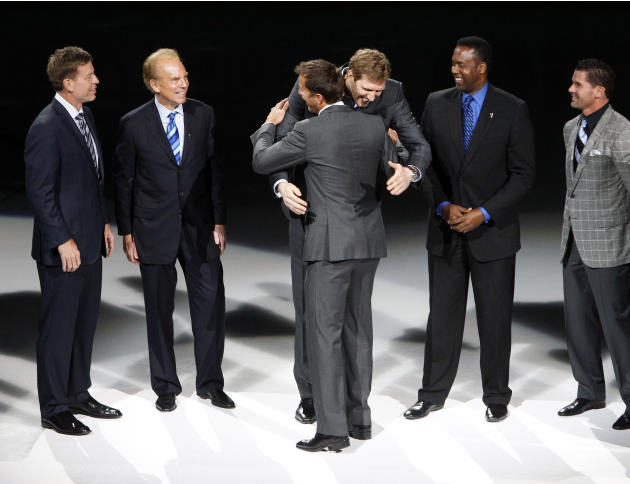 Other Dallas sports legends Troy Aikman, Roger Staubach, Dirk Nowitzki, Rolando Blackman and Michael Young congratulate Mike Modano during a jersey retirement ceremony at American Airlines Center in D