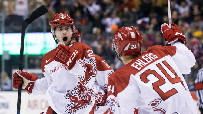Denmark's Oliver Bjorkstrand, left, celebrates with Nikolaj Ehlers after scoring his team's opening goal against Russia during the first period of a preliminary round game at the World junior hockey championships in Toronto on Friday, Dec. 26, 2014. (AP Photo/The Canadian Press, Chris Young)