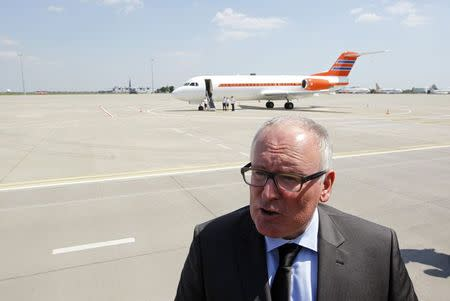 Dutch Foreign Minister Timmermans talks to journalists during his visit to Kharkiv airport as remains of passengers of downed Malaysia Airlines Flight MH17 airliner are loaded into a plane, in Kharkiv