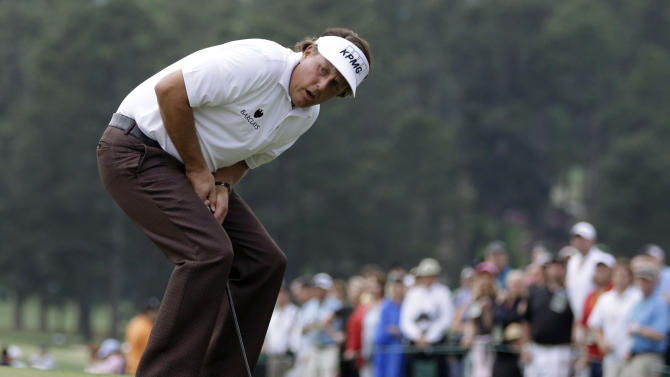 Phil Mickelson reacts after missing a putt on the 18th green during the first round of the Masters golf tournament Thursday, April 11, 2013, in Augusta, Ga. (AP Photo/Darron Cummings)