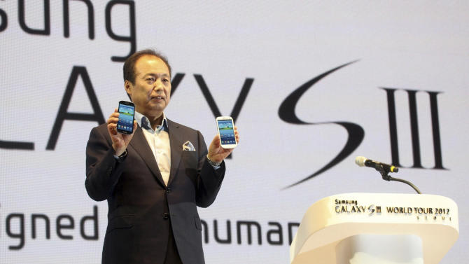 In this photo released by Samsung Electronics Co., Shin Jong-kyun, president of Samsung's mobile communications business, poses with Samsung Electronics' newest smartphone Galaxy S III during its world tour in Seoul, South Korea, Monday, June 25, 2012. Samsung Electronics, the world's top mobile phone maker, said Monday it expects global sales of the latest Galaxy smartphone to surpass 10 million in July even as it struggles to keep up with demand because of component shortages. (AP Photo/Samsung Electronics) NO SALES