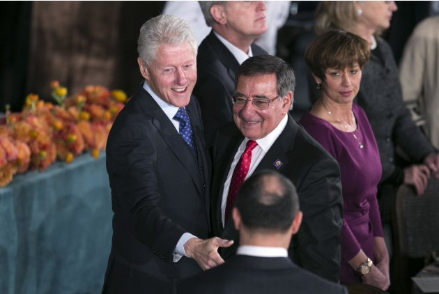 Former U.S. President Clinton and Secretary of Defense Panetta talk during the Inaugural Luncheon in Washington