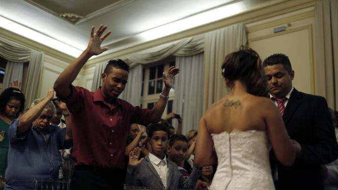 Guests take part in a group wedding celebrated by an evangelical pastor in Rio de Janeiro