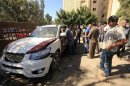 A car belonging to Colonel Mohammed Ben Haleem is seen after it exploded in Benghazi