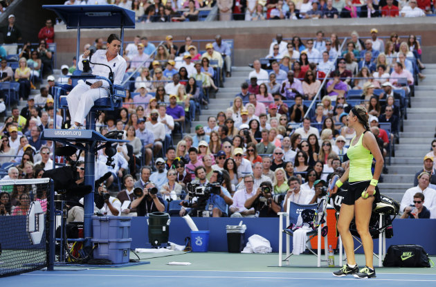 Victoria Azarenka of Belarus, right, argues with the chair umpire during the championship match against Serena Williams at the 2012 US Open tennis tournament,  Sunday, Sept. 9, 2012, in New York. (AP
