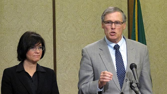 Washington state Gov. Jay Inslee, right, is joined by Maia Bellon, director of the Department of Ecology, at a news conference to discuss a tank leak at Hanford Nuclear Reservation, on Friday, Feb. 15, 2013, in Olympia, Wash. The U.S. Department of Energy said liquid levels are decreasing in one of 177 underground tanks, but that higher radiation levels have not been detected. (AP Photo/Rachel La Corte)