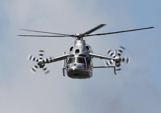 The Eurocopter X3 Hybrid helicopter performs its demonstration flight at the 49th Paris Air Show at Le Bourget airport, east of Paris, Wednesday June 22, 2011. (AP Photo/Francois Mori)