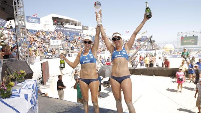 IMAGE DISTRIBUTED FOR CELEBRITY CRUISES - Team USA's Jennifer Kessy and April Ross win the World Series of Beach Volleyball Finals at Celebrity Cruises' Taste of Modern Luxury Culinary & Spa Tour on Sunday July 28, 2013 in Long Beach, Calif. (Photo by Todd Williamson/Invision for Celebrity Cruises/AP)