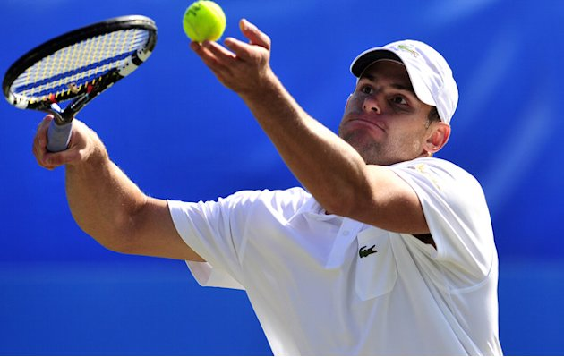 Andy Roddick Of The US Serves AFP/Getty Images