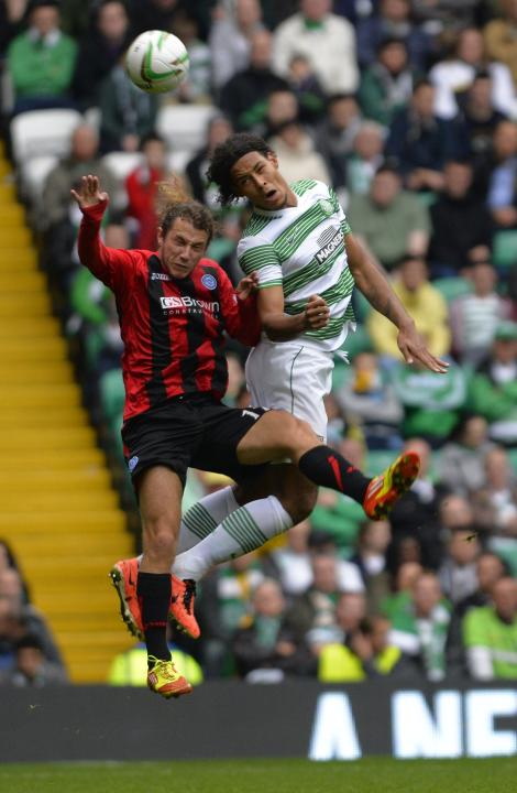 Celtic's van Djik challenges St. Johnstone's May during their Scottish Premier League soccer match at Celtic Park Stadium in Glasgow