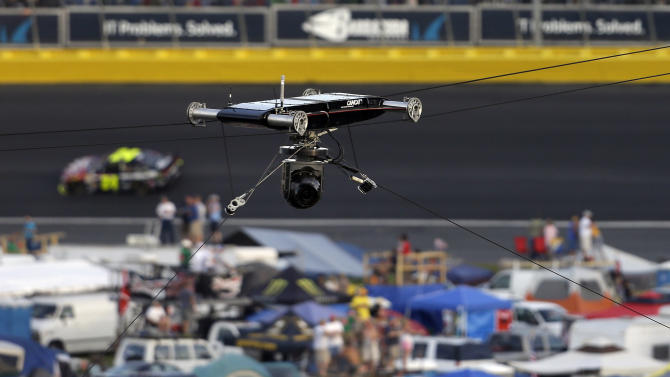 A cable rig on a television camera hangs broken over the track at the NASCAR Sprint Cup Series Coca-Cola 600 auto race at the Charlotte Motor Speedway in Concord, N.C., Sunday, May 26, 2013. The race was red flagged as a result. Several cars ran over the cable, damaging the race cars. (AP Photo/Gerry Broome)