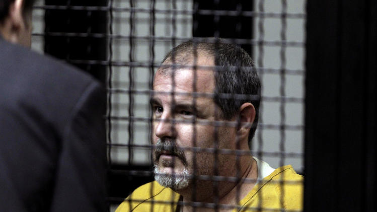 Scott Dekraai appears in a courtroom in Santa Ana, Calif., Friday, Oct. 14, 2011. Arraignment of the suspect in the Seal Beach, Calif., hair salon massacre has been postponed. Dekraai was to have been arraigned in Orange County Superior Court Friday afternoon but the proceeding was continued to Nov. 29. (AP Photo/Jae C. Hong)