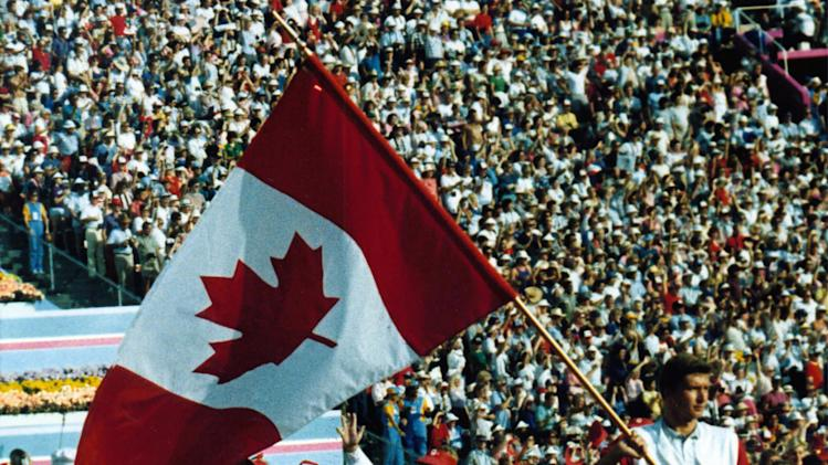 Alex Baumann carries the Canadian flag at the opening of the 1984 Summer Olympic Games