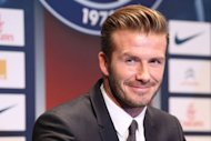 Former England captain David Beckham gives a press conference at the Parc des Princes stadium in Paris, on January 31, 2013, to announce that he joined the French football club Paris Saint Germain (PSG).