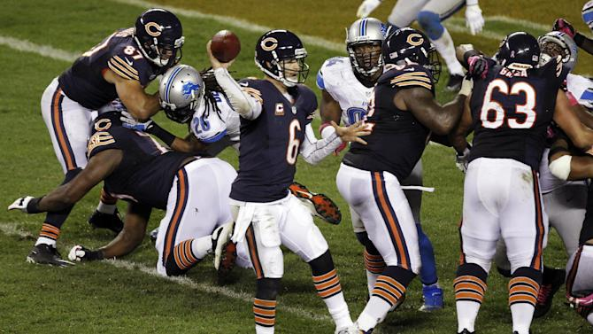 Chicago Bears quarterback Jay Cutler (6) throws a pass against the Detroit Lions in the second half of an NFL football game in Chicago, Monday, Oct. 22, 2012. (AP Photo/Kiichiro Sato)