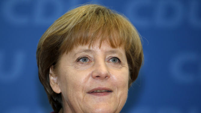 German Chancellor and chairwoman of the German Christian Democrats, CDU, Angela Merkel, smiles at the beginning of the party's weekly executive committee meeting in Berlin, Germany, Monday, March 26, 2012 one day after the Saarland state elections. Chancellor Angela Merkel's party won the  state election in western Germany Sunday, making a promising start to a difficult series of regional ballots this year. (AP Photo/Michael Sohn)