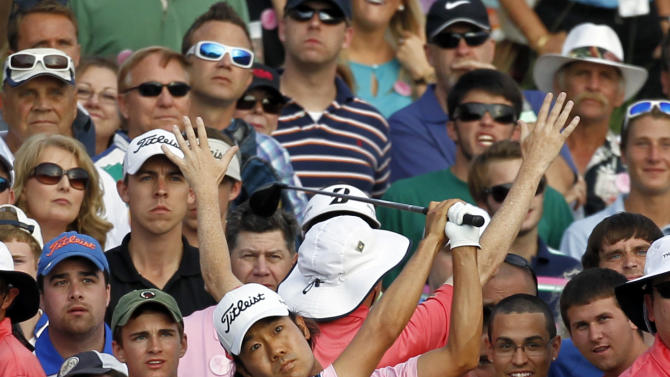 Kevin Na hits from the cart patch on the 18th hole during the final round of the Players Championship golf tournament at TPC Sawgrass, Sunday, May 13, 2012, in Ponte Vedra Beach, Fla. (AP Photo/Chris O'Meara)