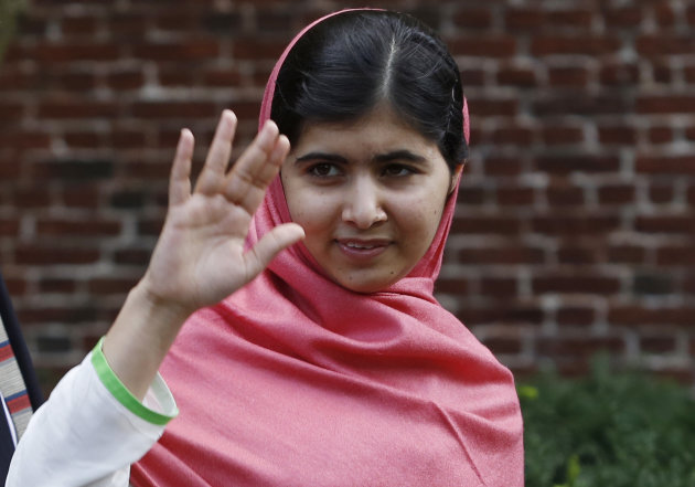 Malala Yousafzai, waves to onlookers after speaking at a news conference on the Harvard University campus in Cambridge, Mass. on Friday, Sept. 27, 2013. The Pakistani teenager, an advocate for education for girls, survived a Taliban assassination attempt in 2012 on her way home from school. (AP Photo/Jessica Rinaldi)