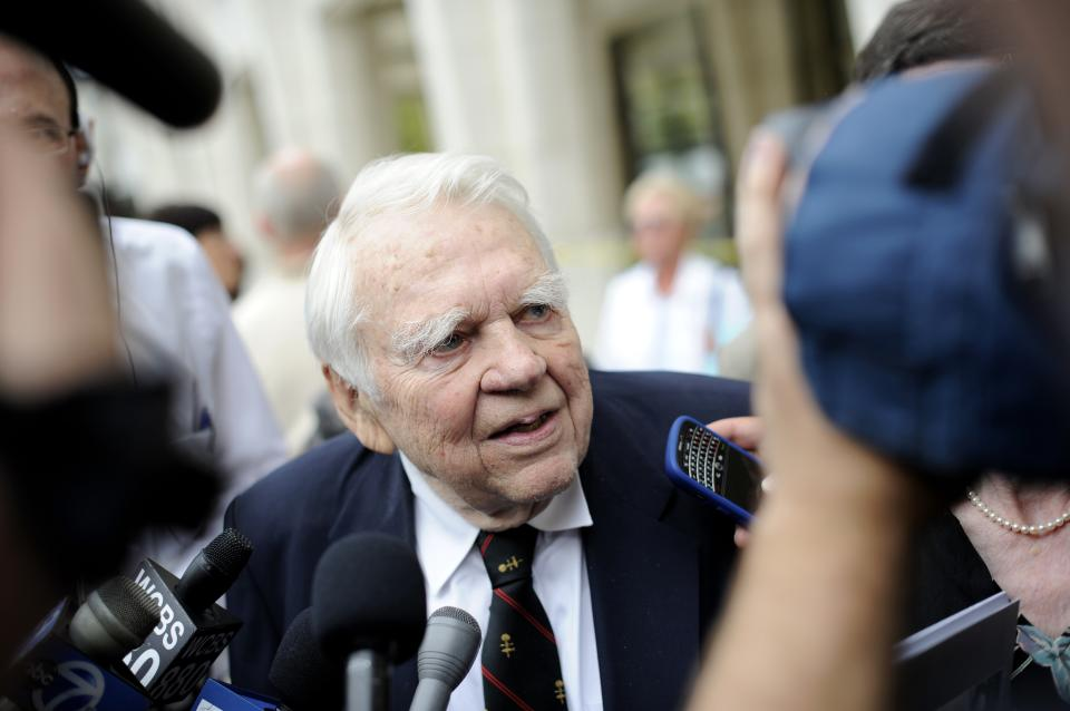 "FILE - In this Aug. 9, 2009 file photo, 60 Minutes' Andy Rooney, center leaves the Celebration of Life Memorial ceremony for Walter Cronkite at Avery Fisher Hall in New York. CBS says former ""60 Minutes"" commentator Andy Rooney died at age 92. (AP Photo/Stephen Chernin, File)"